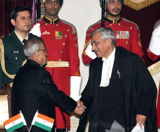 The President, Shri Pranab Mukherjee greets the Chief Justice of India, Shri Justice T.S. Thakur, after administering the oath of office to him, at a swearing-in ceremony, at Rashtrapati Bhavan, in New Delhi on December 03, 2015.