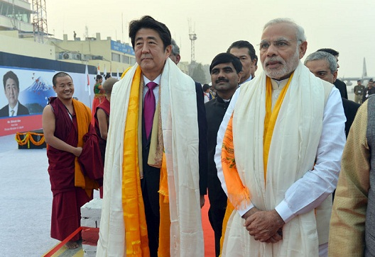 Prime Minister, Narendra Modi and the PM of Japan, Mr. Shinzo Abe being given traditional welcome, on their arrival at Varanasi, Uttar Pradesh.