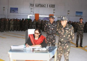 The Union Minister for Defence, Smt. Nirmala Sitharaman putting her remarks in Visitor's Book at Air Force Station Leh, during her maiden visit to Leh/Siachen sector, in Leh on September 30, 2017.