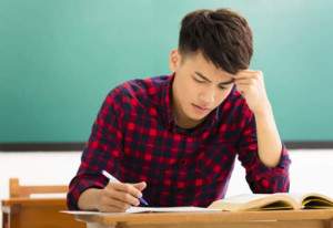 student  studying for exam in classroom